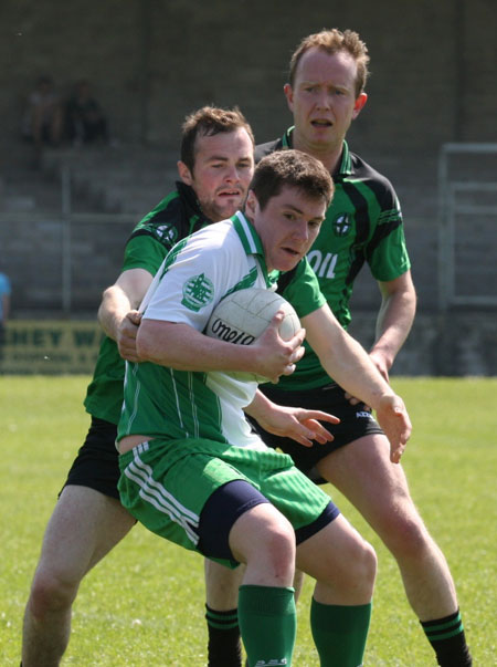 Action from the senior secondary league game against Naomh Bríd.