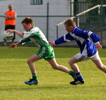 Action from the under 14 league game against Four Masters.