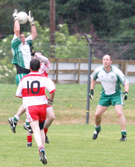 Action from the Junior B championship play-off against Glenfin.