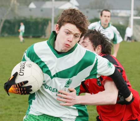 Action from the reserve senior division three match against Naomh Bríd.