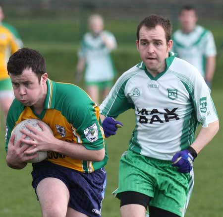 Action from the reserve senior division three match against Downings.