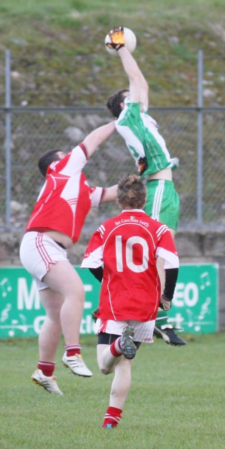 Action from the under 18 league clash between Aodh Ruadh and Dungloe.