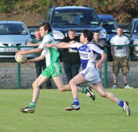 Action from the intermediate championship play-off match against Fanad Gaels.