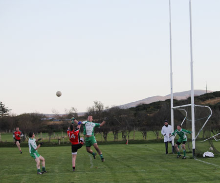Action from the division three football league match against Urris.