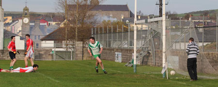 Action from the Senior Reserve Football Division 3 match against Naomh Colmcille.