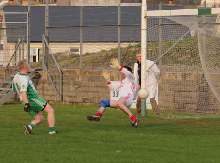 Action from the division three football league match against Naomh Cholmcille.