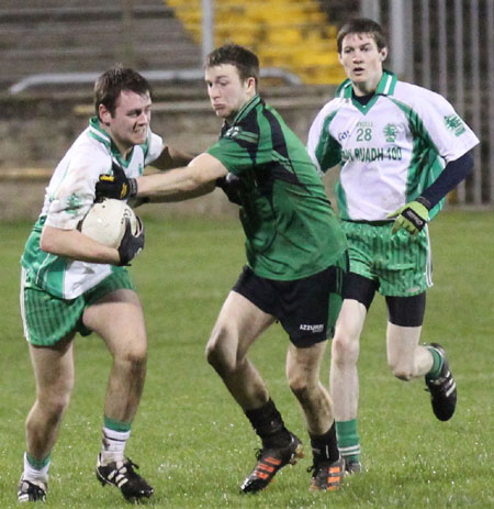 Action from the division three football league play-off match against Naomh Bríd.