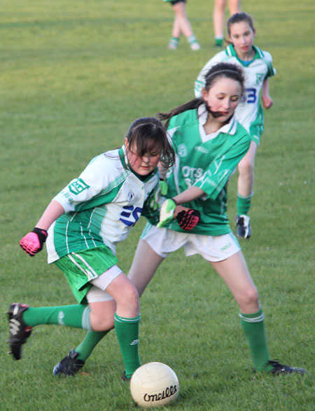 Action from the 2012 ladies under 14 match between Aodh Ruadh and Saint Naul's.