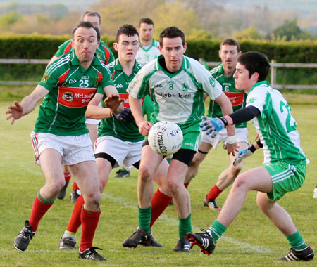 Action from the division three senior football league match against Carndonagh.