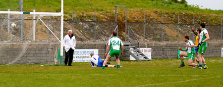 Action from the division three senior football league match against Burt.