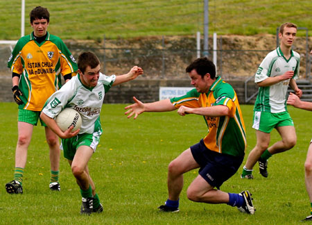 Action from the division three senior reserve football league match against Downings.