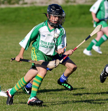 Action from the under 12 hurling game between Aodh Ruadh and Four Masters.