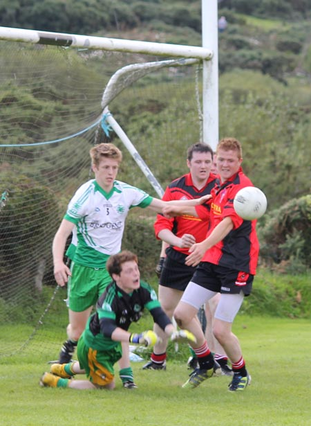 Action from the division three senior reserve football league match against Urris.