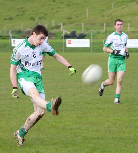 Action from the intermediate reserve football championship game against Naomh Bríd.