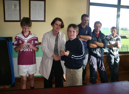 Briege Daly presenting Primary League Shield to Letterkenny Gaels captain Conor Sweeney.