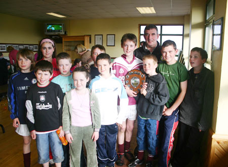 Tom Daly with the victorious Letterkenny Gaels team.
