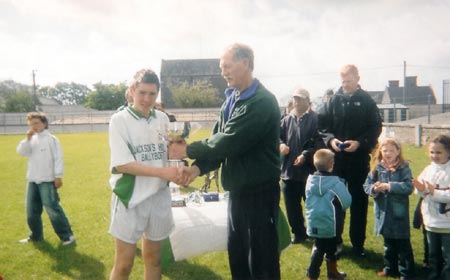 The McCumhaill's captain, Martin O' Reilly being presented with the Alan Ryan Cup by Martin 'Kerry' Ryan.