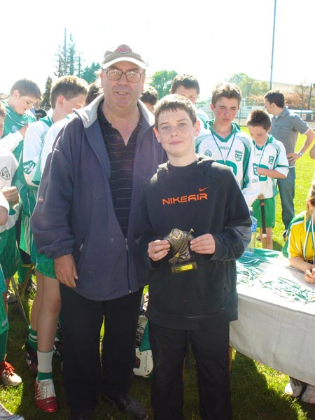 Billy Finn presenting the Pat Butler Memorial save of the tournament trophy to  Conor Taheny from Coolera Strandhill.