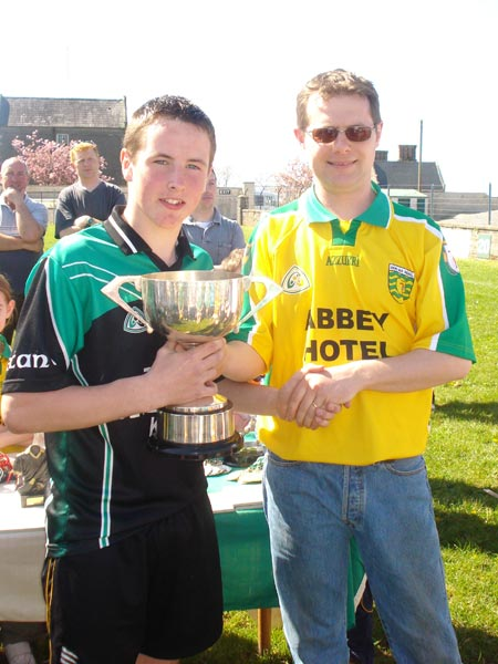 Niall Ryan presenting `the Setanta captain with the Alan Ryan Memorial Cup.