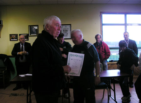 Alan Kane receives a certificate commemorating his participation in the Bakery Cup from the Chairman of Bord na n�g, Jim Kane.