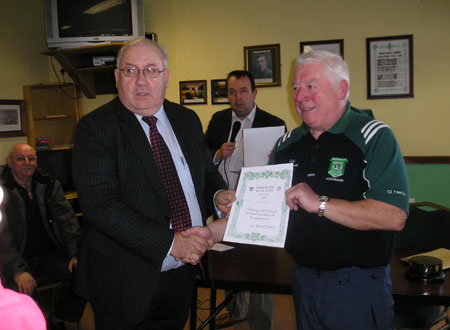 Padraig McGarrigle receives a certificate commemorating his participation in the Bakery Cup from the Chairman of Bord na n�g, Jim Kane.