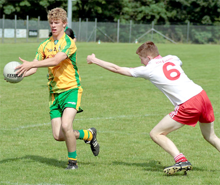 Niall Harley gets a shot away during the Buncrana cup final.