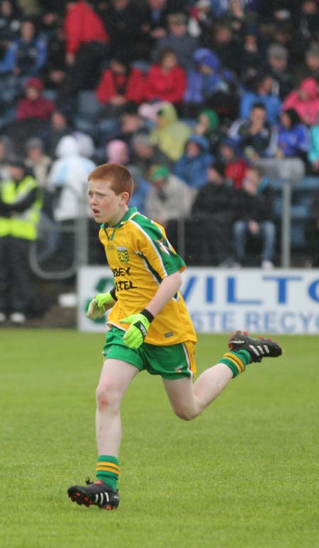 Aodh Ruadh's Shane McGrath plays the half-time mini-games at Breffni park.
