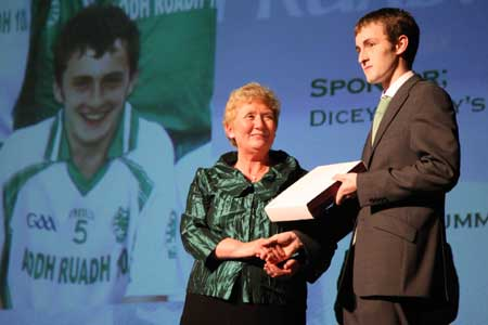 Aodh Ruadh Treasurer, Mary Grimes, presents Ronan Drummond with the third team player of the year award.