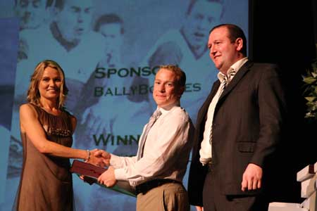 Paula Keon presents Philip O'Reilly with the Ciaran Keon senior player of the year award as senior team sponsor, John Patton watches on.