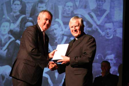 Christy Cooney makes the presentation to Father Gerard Daly.