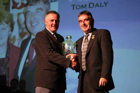 Terence McShea makes the presentation to Tom Daly.