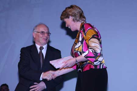 Club Secretary, John Magee, presents the T�naiste, Mary Couaghlan, with a token of appreciation.