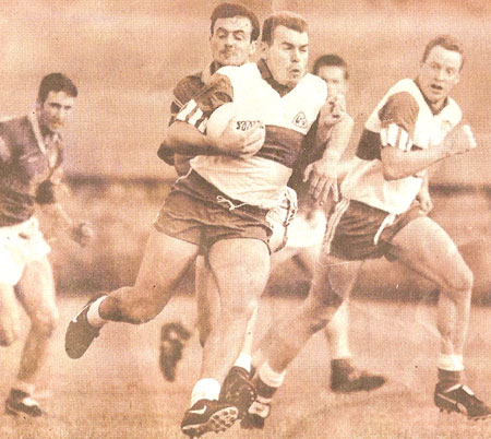 Ciaran breaks out with the ball against Naomh Columba during the 1997 Senior Championship.