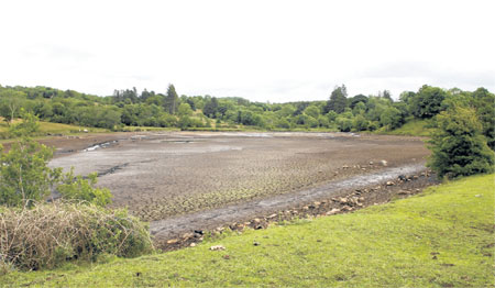 Corlea GAA pitch, which was revealed at the Knather, Ballyshannon when the Assaroe Lake between Cathleen's Falll and Cliff Hydro Stations was lowered for maintenance work to be carried out.
