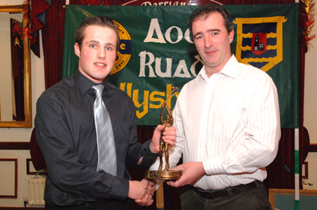 Stephen Ryan recieves the Young Hurler award from John Rooney.