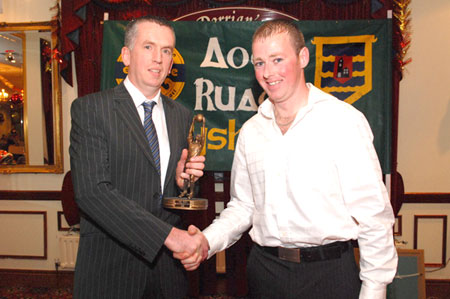 Gerard McGloin presents Brian Dorrian with the Third team player of the year award.