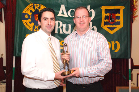 Barry Travers receives the Reserve Player of the year award from Val Murray.
