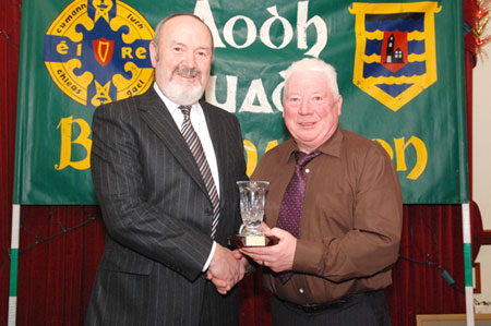 Outgoing Bord na nOg Chairman Jim Kane receives an appreciation award from John Travers.