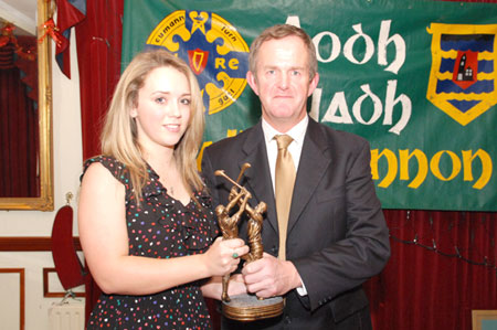 John Larkin presents Ashling Finn with the services for Hurling award, on behalf of her father, Billy.
