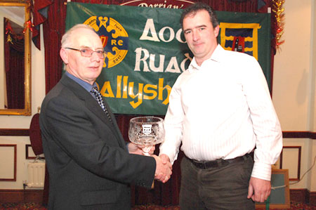John Magee presents John Rooney with the Club Person award.