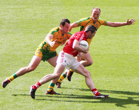 Action from the All-Ireland Senior Football Championship semi-final between Donegal and Cork.