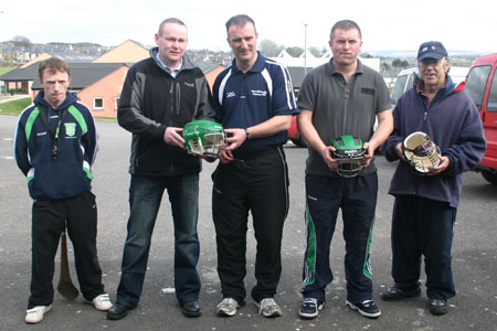 Brendan Whoriskey, Traveller's Rest, Cashelard, handing over a set of helmets to John Rooney, Chairman, Aodh Ruadh Hurling committee. Also present, Peter Horan, under 14 manager, Kevin Loughlin, under 16 manager and Billy Finn.