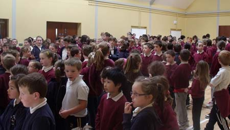 Pupils in Creevy National School wait for sight of the Lory Meagher trophy.
