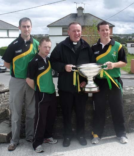 Father McManus gets his hands on the Lory Meagher.
