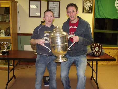 Peter Horan and Michael Fennelly holding the Bob O'Keefe cup.