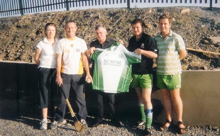 Mr. Pat Devine presenting a set of minor jerseys to the Aodh Ruadh minor huling team. Pictured is Emma Gaughan (hurling secretary), Thomas Gallagher, Pat Devine (Devine's transport), Kevin Loughlin (Minor team manager) and Dennis Doherty (hurling Chairman).
