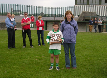 Noreen Shannon presents the 'B' Shield to the Aodh Ruadh Captain, Patrick Herron, after the final of the Michael Shannon under 10 tournament in Ballyshannon last Saturday.