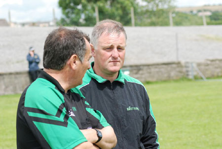 Shane Toolan and Terence McShea watch on.