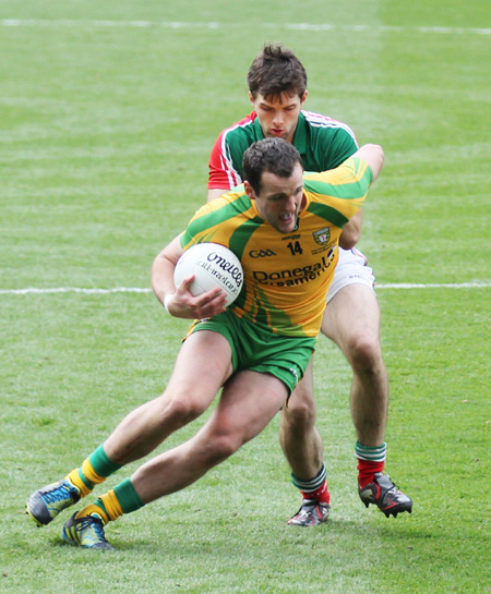 Action from the All-Ireland Senior Football Championship final between Donegal and Mayo.