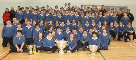 Students and teaching staff  from Colaiste Cholmcille, Ballyshannon pictured with the Sam Maguire, Tom Markham (All-Ireland minor football championship) and McKenna cups when they visited their school last Friday..